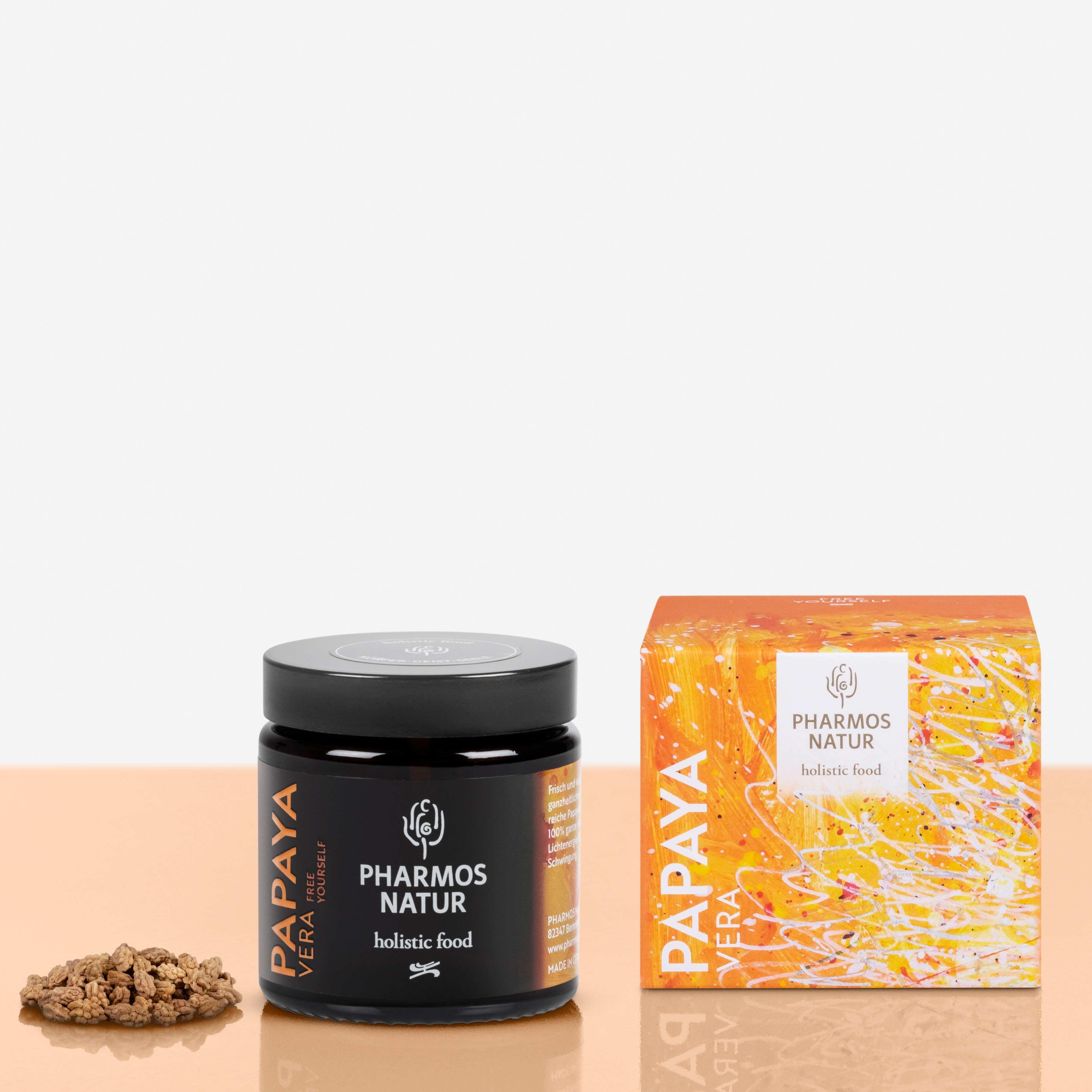 Papaya Vera dunkler Behälter Produktbild neben Pulver und Verpackung