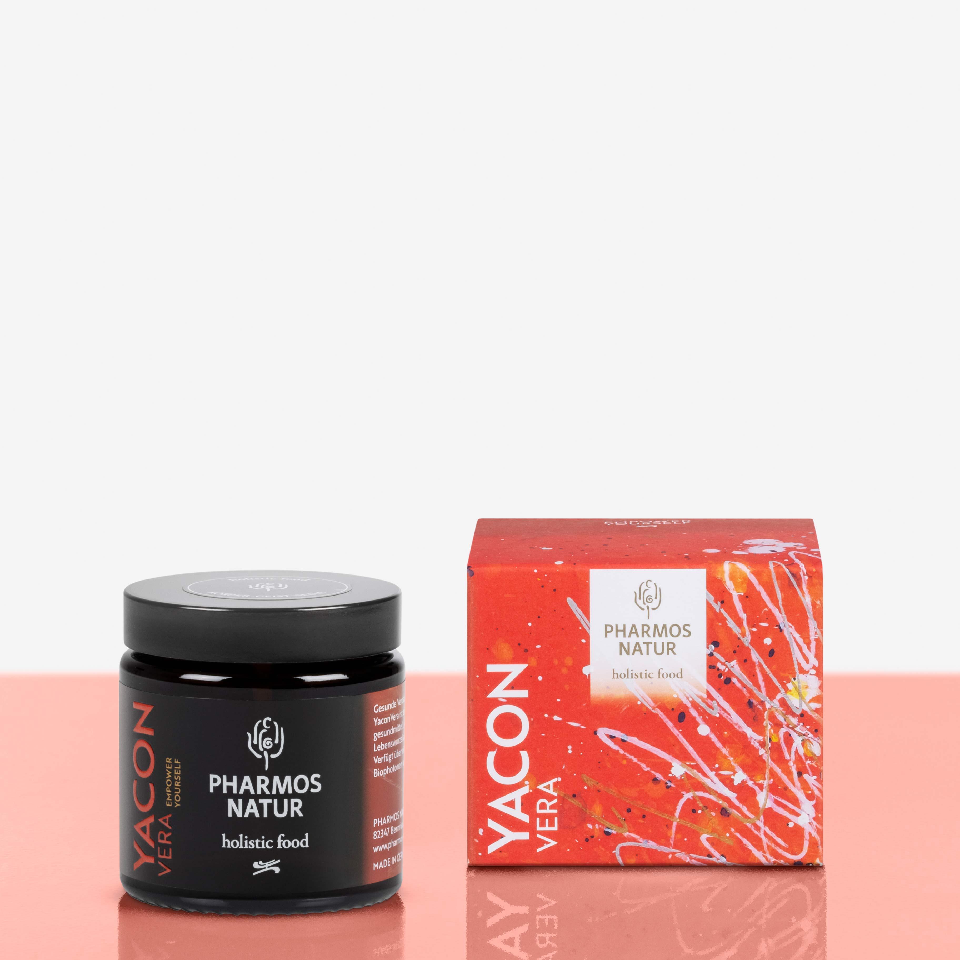 Yacon Vera dunkler Behälter neben roter Verpackung Produktbild