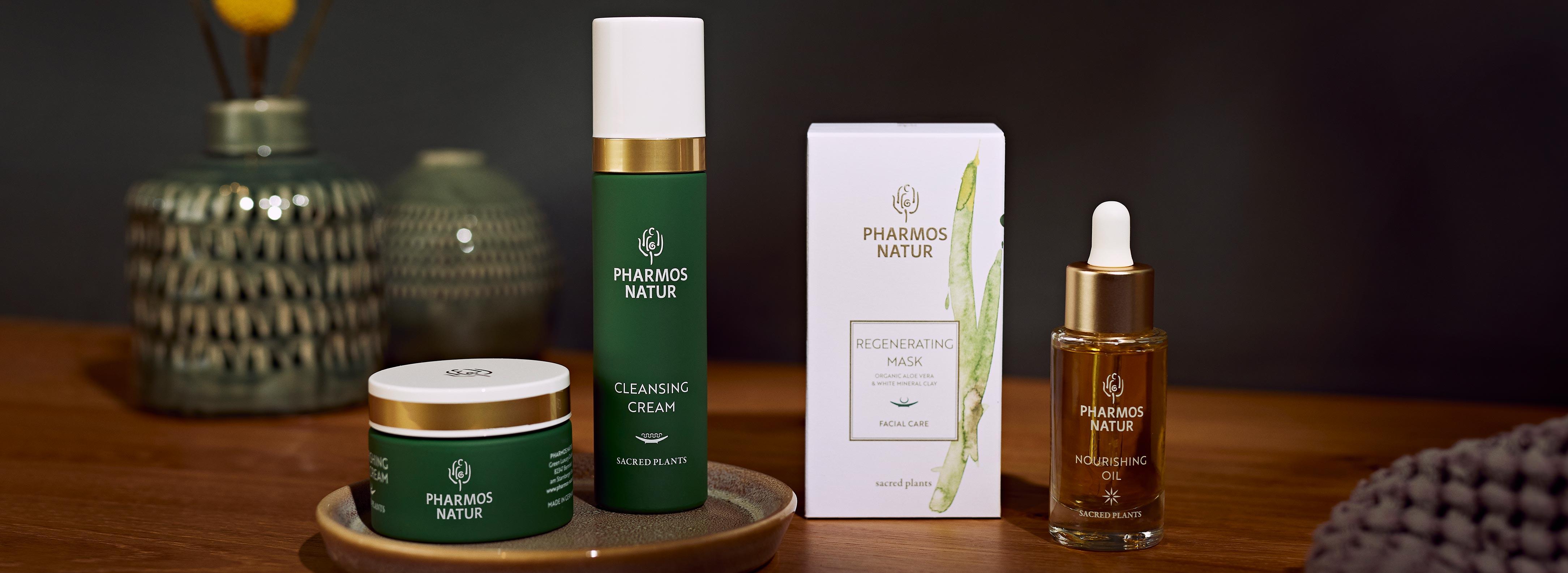 Pharmos Natur Produkte für den Hauttyp trockene Haut mit dunklem Hintergrund